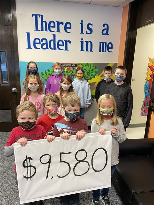 11 children with sign that says $9,580